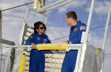 KENNEDY SPACE CENTER, FLA. -- During emergency egress training, part of Terminal Countdown Demonstration Test activities at the pad, STS-107 Mission Specialists Kalpana Chawla and David Brown share a slidewire basket. The TCDT also includes a simulated launch countdown. STS-107 is a mission devoted to research and will include more than 80 experiments that will study Earth and space science, advanced technology development, and astronaut health and safety. Launch is planned for Jan. 16, 2003, between 10 a.m. and 2 p.m. EST aboard Space Shuttle Columbia. .