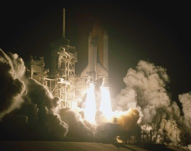 KENNEDY SPACE CENTER, Fla. - Billows of smoke and steam flow over the launch pad as Space Shuttle Columbia leaps into space on mission STS-109. Liftoff occurred at 6:22:02:08 a.m. EST (11:22:02:08 GMT). This was the 27th flight of the vehicle and 108th in the history of the Shuttle program. The goal of mission STS-109 is the maintenance and upgrade of the Hubble Space Telescope, to be carried out in five spacewalks. The crew comprises Commander Scott D. Altman, Pilot Duane G. Carey, Payload Commander John M. Grunsfeld, and Mission Specialists Nancy Jane Currie, Richard M. Linnehan, James H. Newman and Michael J. Massimino. After the 11-day mission, Columbia is expected to return to KSC March 12 about 4:35 a.m. EST (09:35 GMT).