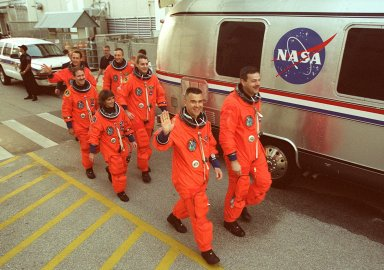 KENNEDY SPACE CENTER, FLA. -- The STS-109 crew walks toward the Astrovan for a ride to the launch pad. Leading the way are Commander Scott Altman and Pilot Duane Carey; behind them are Mission Specialist Nancy Currie followed by Payload Commander John Grunsfeld (left) and Mission Specialist Rick Linnehan (right); in the rear are Mission Specialists James Newman and Michael Massimino. The crew is taking part in Terminal Countdown Demonstration Test activities that include emergency egress training and a simulated countdown at the pad. Columbia is scheduled to be launched Feb. 28 on mission STS-109, a Hubble Servicing Mission. The goal of the mission is to replace Solar Array 2 with Solar Array 3, replace the Power Control Unit, remove the Faint Object Camera and install the ACS, install the Near Infrared Camera and Multi-Object Spectrometer (NICMOS) Cooling System, and install New Outer Blanket Layer insulation. The launch will be the first for Columbia after returning from California where it underwent extensive maintenance, inspections and enhancements. More than 100 upgrades make Columbia safer and more reliable than ever before
