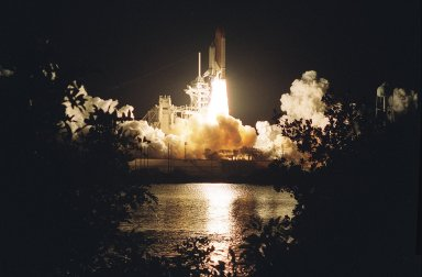 KENNEDY SPACE CENTER, Fla. - Trees and shrubs are silhouetted on the near bank by the brilliant exhaust of Space Shuttle Columbia as it hurtles into the pre-dawn sky on mission STS-109. Liftoff of Columbia occurred at 6:22:02:08 a.m. EST (11:22:02:08 GMT). This was the 27th flight of the vehicle and 108th in the history of the Shuttle program. The goal of the mission is the maintenance and upgrade of the Hubble Space Telescope, to be carried out in five spacewalks. The crew comprises Commander Scott D. Altman, Pilot Duane G. Carey, Payload Commander John M. Grunsfeld, and Mission Specialists Nancy Jane Currie, Richard M. Linnehan, James H. Newman and Michael J. Massimino. After the 11-day mission, Columbia is expected to return to KSC March 12 about 4:35 a.m. EST (09:35 GMT)