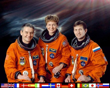 JOHNSON SPACE CENTER, HOUSTON, TEXAS -- EXPEDITION FIVE CREW PORTRAIT --- (JSC ISS05-5-002) -- Cosmonaut Valeri G. Korzun (left), Expedition Five mission commander; astronaut Peggy A. Whitson and cosmonaut Sergei Y. Treschev, both flight engineers, attired in training versions of the shuttle launch and entry suit, pause from their training schedule for a crew portrait. The three will be launched to the International Space Station (ISS) in early spring of this year aboard the Space Shuttle Atlantis. Korzun and Treschev represent the Russian Aviation and Space Agency (Rosaviakosmos)