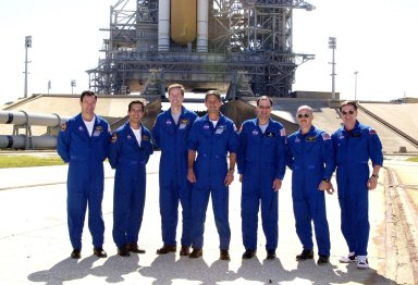 KENNEDY SPACE CENTER, FLA. - The STS-113 and Expedition 6 crews pause for a photo during Terminal Countdown Demonstration Test activities at the pad. From left are STS-113 Mission Specialists Michael Lopez-Alegria and John Herrington, Commander James Wetherbee and Pilot Paul Lockhart; Expedition 6 astronaut Donald Pettit, Commander Ken Bowersox and cosmonaut Nikolai Budarin. The TCDT also includes a simulated launch countdown. The 16th assembly flight to the International Space Station, STS-113 will carry the Port 1 (P1) truss aboard Space Shuttle Endeavour as well as the Expedition 6 crew, who will replace Expedition 5 on the Station. Mission STS-113 is scheduled to launch Nov. 10, 2002.