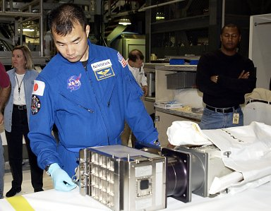 KENNEDY SPACE CENTER, FLA. -- STS-114 Mission Specialist Soichi Noguchi, with the National Space Development Agency of Japan (NASDA), works with equipment that will fly on the mission. The STS-114 crew is participating in familiarization activities with the hardware that will fly on the mission. STS-114 is a utilization and logistics flight (ULF-1) that will carry Multi-Purpose Logistics Module Raffaello and the External Stowage Platform (ESP-2), as well as the Expedition 7 crew, to the International Space Station. Launch is targeted for March 1, 2003.
