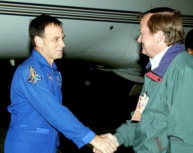 """KENNEDY SPACE CENTER, FLA. -- STS-107 Payload Specialist Ilan Ramon (left) is greeted on his arrival by Launch Director Mike Linebach. Ramon is the first Israeli astronaut to fly on a Shuttle mission. STS-107 is a mission devoted to research and will include more than 80 experiments that will study Earth and space science, advanced technology development, and astronaut health and safety. The payload on Space Shuttle Columbia includes FREESTAR (Fast Reaction Experiments Enabling Science, Technology, Applications and Research) and the SHI Research Double Module (SHI/RDM), known as SPACEHAB. Experiments on the module range from material sciences to life sciences. Other crew members are Commander Rick Husband, Pilot William """"Willie"""" McCool, Payload Commander Michael Anderson and Mission Specialists Kalpana Chawla, David Brown and Laurel Clark. Launch of Columbia is targeted for Jan. 16 between 10 a.m. and 2 p.m."""