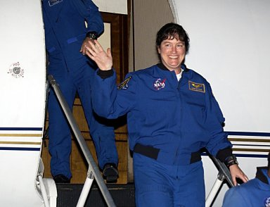 """KENNEDY SPACE CENTER, FLA. - STS-107 Mission Specialist Laurel Clark waves to onlookers as she arrives at KSC for pre-launch preparations. STS-107 is a mission devoted to research and will include more than 80 experiments that will study Earth and space science, advanced technology development, and astronaut health and safety. The payload on Space Shuttle Columbia includes FREESTAR (Fast Reaction Experiments Enabling Science, Technology, Applications and Research) and the SHI Research Double Module (SHI/RDM), known as SPACEHAB. Experiments on the module range from material sciences to life sciences. The crew includes Payload Specialist Ilan Ramon, the first Israeli astronaut. Other crew members are Commander Rick Husband, Pilot William """"Willie"""" McCool, Payload Commander Michael Anderson and Mission Specialists Kalpana Chawla and David Brown. Launch of Columbia is targeted for Jan. 16 between 10 a.m. and 2 p.m."""