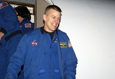 """KENNEDY SPACE CENTER, FLA. - STS-107 Pilot William """"Willie"""" McCool smiles at spectators as he arrives at KSC for pre-launch preparations. STS-107 is a mission devoted to research and will include more than 80 experiments that will study Earth and space science, advanced technology development, and astronaut health and safety. The payload on Space Shuttle Columbia includes FREESTAR (Fast Reaction Experiments Enabling Science, Technology, Applications and Research) and the SHI Research Double Module (SHI/RDM), known as SPACEHAB. Experiments on the module range from material sciences to life sciences. The crew includes Payload Specialist Ilan Ramon, the first Israeli astronaut. Other crew members are Commander Rick Husband, Payload Commander Michael Anderson and Mission Specialists Kalpana Chawla, David Brown and Laurel Clark. Launch of Columbia is targeted for Jan. 16 between 10 a.m. and 2 p.m."""