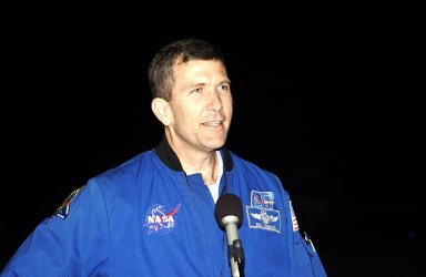 """KENNEDY SPACE CENTER, FLA. -- STS-107 Commander Rick Husband makes a few comments after the crew's arrival at KSC for pre-launch preparations. Other crew members are Pilot William """"Willie"""" McCool, Payload Commander Michael Anderson, Payload Specialist Ilan Ramon, and Mission Specialists Kalpana Chawla, David Brown and Laurel Clark. Ramon is the first Israeli astronaut to fly on a Shuttle mission. STS-107 is a mission devoted to research and will include more than 80 experiments that will study Earth and space science, advanced technology development, and astronaut health and safety. The payload on Space Shuttle Columbia includes FREESTAR (Fast Reaction Experiments Enabling Science, Technology, Applications and Research) and the SHI Research Double Module (SHI/RDM), known as SPACEHAB. Experiments on the module range from material sciences to life sciences. Launch of Columbia is targeted for Jan. 16 between 10 a.m. and 2 p.m."""