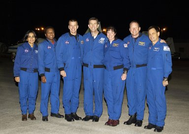 """KENNEDY SPACE CENTER, FLA. - The STS-107 crew pose for a photo after their arrival at KSC for pre-launch preparations. Standing from left to right are Mission Specialist Kalpana Chawla, Payload Commander Michael Anderson, Pilot William """"Willie"""" McCool, Commander Rick Husband, Mission Specialists Laurel Clark and David Brown, and Payload Specialist Ilan Ramon, who is the first Israeli astronaut to fly on a Shuttle mission. STS-107 is a mission devoted to research and will include more than 80 experiments that will study Earth and space science, advanced technology development, and astronaut health and safety. The payload on Space Shuttle Columbia includes FREESTAR (Fast Reaction Experiments Enabling Science, Technology, Applications and Research) and the SHI Research Double Module (SHI/RDM), known as SPACEHAB. Experiments on the module range from material sciences to life sciences. Launch of Columbia is targeted for Jan. 16 between 10 a.m. and 2 p.m."""