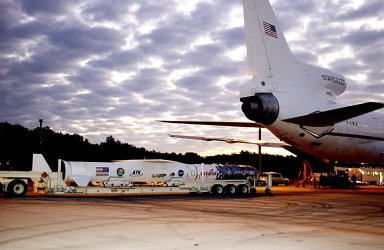 KENNEDY SPACE CENTER, FLA. - The Pegasus XL launch vehicle, with the Solar Radiation and Climate Experiment (SORCE) satellite aboard, arrives at Cape Canaveral Air Force Station (CCAFS), Fla. At right is the L-1011 aircraft that will carry the Pegasus to the launch altitude of 39,000 feet over the Atlantic Ocean approximately 100 miles east-southeast of Cape Canaveral. SORCE, built by Orbital Sciences Corporation, will study and measure solar irradiance as a source of energy in the Earth's atmosphere. The launch of SORCE is scheduled for Jan. 25 at 3:14 p.m. from CCAFS.