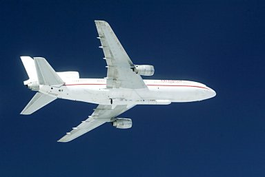 KENNEDY SPACE CENTER, FLA. -- The L-1011 aircraft soars through the sky over the Atlantic Ocean with a Pegasus XL rocket, containing NASA's Solar Radiation and Climate Experiment (SORCE), attached underneath. The rocket will be dropped from the aircraft at 3:14 p.m. EST. Over the next few days, the mission team will insure that the spacecraft is functioning properly. The SORCE science instruments will then be turned on and their health verified. Approximately 21 days after launch, if all is going well, the instruments will start initial science data collection and calibration will begin. The spacecraft will study the Sun's influence on our Earth and will measure from space how the Sun affects the Earth's ozone layer, atmospheric circulation, clouds, and oceans. This mission is a joint partnership between NASA and the University of Colorado's Laboratory for Atmospheric and Space Physics in Boulder, Colorado. [Photo courtesy of Jeff Caplan, Langley Research]