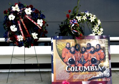 KENNEDY SPACE CENTER, FLA. -- Among the many floral tributes to honor the fallen crew of Columbia is this wreath, presented by Center Director Roy Bridges and Deputy Director James Kennedy. The site is the Astronauts Memorial Space Mirror at the KSC Visitor Complex. The mirror is a national tribute to the earlier 17 American astronauts who also gave their lives to the quest to explore space. .