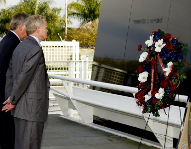KENNEDY SPACE CENTER, FLA. -- After placing a wreath in front of the Astronauts Memorial Space Mirror at the KSC Visitor Complex, Center Director Roy Bridges and Deputy Director James Kennedy pause for moment of reflection. The mirror is a national tribute to the earlier 17 American astronauts who also gave their lives to the quest to explore space. The site has been inundated with flowers from the public to honor the fallen crew of Columbia. .