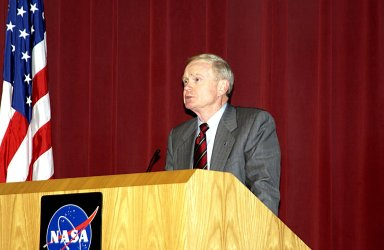 KENNEDY SPACE CENTER, FLA. - Following the loss of Columbia and crew on their return to Earth, Center Director Roy Bridges speaks to employees about the tragedy, the impact on the KSC family and, ultimately, to honor the fallen heroes by continuing the journey into space.