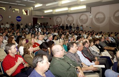 KENNEDY SPACE CENTER, FLA. - Employees listen solemnly as Center Director Roy Bridges speaks about the tragedy of the loss of Columbia and crew, the impact on the KSC family and, ultimately, the need to honor the fallen heroes by continuing the journey into space.