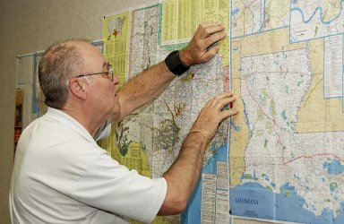 KENNEDY SPACE CENTER, FLA. - Don Maxwell, Safety, United Space Alliance, checks a map of Texas during a meeting of the Recovery Management Team at KSC. The team is part of the investigation into the accident that claimed orbiter Columbia and her crew of seven on Feb. 1, 2003, over East Texas as they returned to Earth after a 16-day research mission. Other team members are Russ DeLoach, chief, Shuttle Mission Assurance Branch, NASA; George Jacobs, Shuttle Engineering; Jeff Campbell, Shuttle Engineering; Dave Rainer, Launch and Landing Operations; the two co-chairs of the Response Management Team, Denny Gagen, Landing Recovery Manager, Chris Hasselbring, Landing Operations, USA; and Larry Ulmer, Safety, NASA. The team is coordinating KSC technical support and assets to the Mishap Investigation Team in Barksdale, La., and providing support for the Recovery teams in Los Angeles, Texas, New Mexico, Arizona and California. In addition, the team is following up on local leads pertaining to potential debris in the KSC area. .