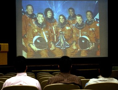 KENNEDY SPACE CENTER, FLA. -- Employees at KSC gather to watch the memorial service for the fallen seven astronauts of Columbia being held at Johnson Space Center, Houston, and broadcast on NASA television. .