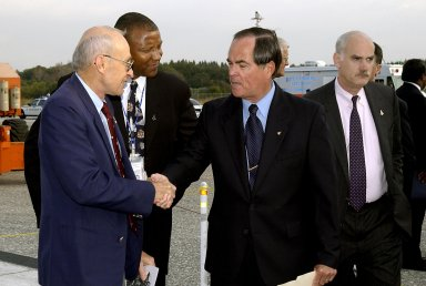 KENNEDY SPACE CENTER, FLA. - A Columbia Crew Memorial Service is held at the Shuttle Landing Facility for KSC employees and invited guests, including former astronaut and KSC Director Robert Crippen (center). The Columbia and her crew of seven were lost on Feb. 1, 2003, over East Texas as they returned to Earth after a 16-day research mission. Taking part in the service were NASA Administrator Sean O?Keefe, former KSC Director Robert Crippen, astronaut Jim Halsell, several employees, area clergymen, and members of Patrick Air Force Base. The service concluded with a ?Missing Man Formation Fly Over? by NASA T-38 jet aircraft.