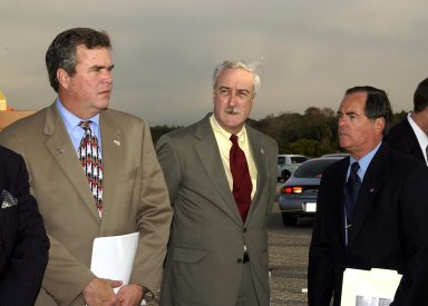 KENNEDY SPACE CENTER, FLA. - A Columbia Crew Memorial Service is held at the Shuttle Landing Facility for KSC employees and invited guests, including Florida Gov. Jeb Bush (left), NASA Administrator Sean O'Keefe (center), and Columbia's first pilot and former KSC Director Robert Crippen (right). The Columbia and her crew of seven were lost on Feb. 1, 2003, over East Texas as they returned to Earth after a 16-day research mission. Taking part in the service were NASA Administrator Sean O?Keefe, former KSC Director Robert Crippen, astronaut Jim Halsell, several employees, area clergymen, and members of Patrick Air Force Base. The service concluded with a ?Missing Man Formation Fly Over? by NASA T-38 jet aircraft.