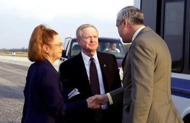 KENNEDY SPACE CENTER, FLA. - A Columbia Crew Memorial Service is held at the Shuttle Landing Facility for KSC employees and invited guests, including KSC Director Roy Bridges (center) and NASA Administrator Sean O'Keefe (right). The Columbia and her crew of seven were lost on Feb. 1, 2003, over East Texas as they returned to Earth after a 16-day research mission. Taking part in the service were NASA Administrator Sean O?Keefe, former KSC Director Robert Crippen, astronaut Jim Halsell, several employees, area clergymen, and members of Patrick Air Force Base. The service concluded with a ?Missing Man Formation Fly Over? by NASA T-38 jet aircraft.