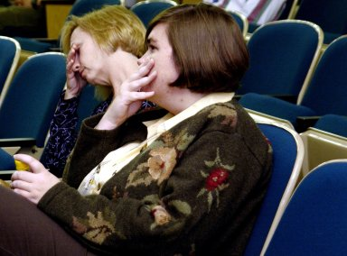 KENNEDY SPACE CENTER, FLA. - Employees at KSC reveal emotion as they watch the memorial service for the fallen seven astronauts of Columbia being held at Johnson Space Center, Houston, and broadcast on NASA television. .