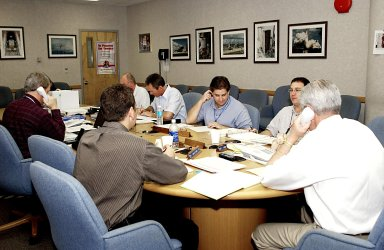 KENNEDY SPACE CENTER, FLA. -- Members of the Recovery Management Team at KSC are at work in the Operations Support Building. They are part of the investigation into the accident that claimed orbiter Columbia and her crew of seven on Feb. 1, 2003, over East Texas as they returned to Earth after a 16-day research mission. Seated around the table (clockwise from far left) are Chris Hasselbring, Landing Operations, USA (co-chair of the Response Management Team); Don Maxwell, Safety, United Space Alliance (USA); Russ DeLoach, chief, Shuttle Mission Assurance Branch, NASA; George Jacobs, Shuttle Engineering; Jeff Campbell, Shuttle Engineering; Denny Gagen, Landing Recovery Manager (second co-chair of the team); and Dave Rainer, Launch and Landing Operations. The team is coordinating KSC technical support and assets to the Mishap Investigation Team in Barksdale, La., and providing support for the Recovery teams in Los Angeles, Texas, New Mexico, Arizona and California. In addition, the team is following up on local leads pertaining to potential debris in the KSC area. .