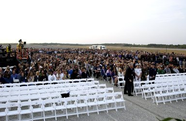 KENNEDY SPACE CENTER, FLA. - Employees at KSC gather at the Shuttle Landing Facility for a Columbia Crew Memorial Service. The Columbia and her crew of seven were lost on Feb. 1, 2003, over East Texas as they returned to Earth after a 16-day research mission. Taking part in the service were NASA Administrator Sean O?Keefe, former KSC Director Robert Crippen, astronaut Jim Halsell, several employees, area clergymen, and members of Patrick Air Force Base. The service concluded with a ?Missing Man Formation Fly Over? by NASA T-38 jet aircraft.