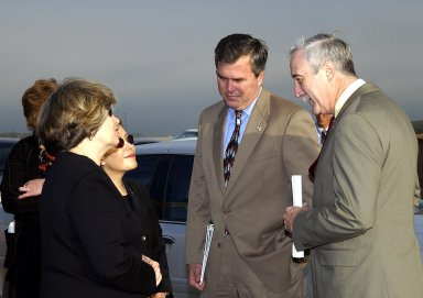 KENNEDY SPACE CENTER, FLA. - A Columbia Crew Memorial Service is held at the Shuttle Landing Facility for KSC employees and invited guests, including Florida Gov. Jeb Bush (second from right) and NASA Administrator Sean O'Keefe (right). The Columbia and her crew of seven were lost on Feb. 1, 2003, over East Texas as they returned to Earth after a 16-day research mission. Taking part in the service were NASA Administrator Sean O?Keefe, former KSC Director Robert Crippen, astronaut Jim Halsell, several employees, area clergymen, and members of Patrick Air Force Base. The service concluded with a ?Missing Man Formation Fly Over? by NASA T-38 jet aircraft.