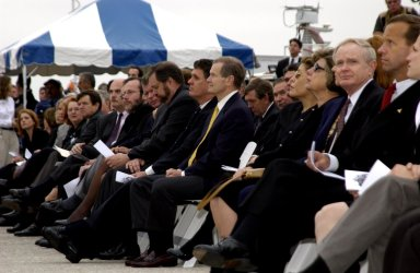 KENNEDY SPACE CENTER, FLA. - A Columbia Crew Memorial Service is held at the Shuttle Landing Facility for KSC employees and invited guests. KSC Director and former astronaut Roy Bridges, Jr., is seated third from right. Florida Senator Bill Nelson, seated in the center (gold tie), also flew on Columbia in 1986 as a payload specialist on mission STS 61-C. The Columbia and her crew of seven were lost on Feb. 1, 2003, over East Texas as they returned to Earth after a 16-day research mission. Taking part in the service were NASA Administrator Sean O?Keefe, former KSC Director Robert Crippen, astronaut Jim Halsell, several employees, area clergymen, and members of Patrick Air Force Base. The service concluded with a ?Missing Man Formation Fly Over? by NASA T-38 jet aircraft.