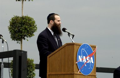 KENNEDY SPACE CENTER, FLA. - A Columbia Crew Memorial Service is held at the Shuttle Landing Facility for KSC employees and invited guests. Rabbi Zvi Konikov of the Chabad Jewish Community Center of the Space Coast is at the podium. The Columbia and her crew of seven were lost on Feb. 1, 2003, over East Texas as they returned to Earth after a 16-day research mission. Taking part in the service were NASA Administrator Sean O?Keefe, former KSC Director Robert Crippen, astronaut Jim Halsell, several employees, area clergymen, and members of Patrick Air Force Base. The service concluded with a ?Missing Man Formation Fly Over? by NASA T-38 jet aircraft.