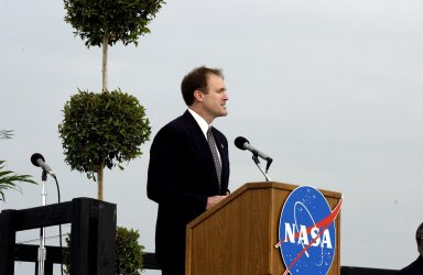 KENNEDY SPACE CENTER, FLA. - A Columbia Crew Memorial Service is held at the Shuttle Landing Facility for KSC employees and invited guests. At the podium is astronaut Jim Halsell. The Columbia and her crew of seven were lost on Feb. 1, 2003, over East Texas as they returned to Earth after a 16-day research mission. Also taking part in the service were NASA Administrator Sean O?Keefe, former KSC Director Robert Crippen, several employees, area clergymen, and members of Patrick Air Force Base. The service concluded with a ?Missing Man Formation Fly Over? by NASA T-38 jet aircraft.