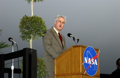 KENNEDY SPACE CENTER, FLA. - A Columbia Crew Memorial Service is held at the Shuttle Landing Facility for KSC employees and invited guests. NASA Administrator Sean O'Keefe is at the podium. The Columbia and her crew of seven were lost on Feb. 1, 2003, over East Texas as they returned to Earth after a 16-day research mission. Taking part in the service were NASA Administrator Sean O?Keefe, former KSC Director Robert Crippen, astronaut Jim Halsell, several employees, area clergymen, and members of Patrick Air Force Base. The service concluded with a ?Missing Man Formation Fly Over? by NASA T-38 jet aircraft.