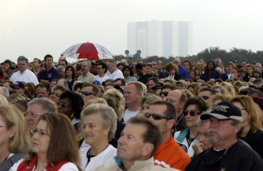 KENNEDY SPACE CENTER, FLA. - With the Vehicle Assembly Building looming in the background, a Columbia Crew Memorial Service is held at the Shuttle Landing Facility for KSC employees and invited guests. The Columbia and her crew of seven were lost on Feb. 1, 2003, over East Texas as they returned to Earth after a 16-day research mission. Taking part in the service were NASA Administrator Sean O?Keefe, former KSC Director Robert Crippen, astronaut Jim Halsell, several employees, area clergymen, and members of Patrick Air Force Base. The service concluded with a ?Missing Man Formation Fly Over? by NASA T-38 jet aircraft.