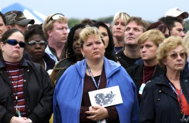 KENNEDY SPACE CENTER, FLA. - A Columbia Crew Memorial Service is held at the Shuttle Landing Facility for KSC employees and invited guests. The Columbia and her crew of seven were lost on Feb. 1, 2003, over East Texas as they returned to Earth after a 16-day research mission. Taking part in the service were NASA Administrator Sean O?Keefe, former KSC Director Robert Crippen, astronaut Jim Halsell, several employees, area clergymen, and members of Patrick Air Force Base. The service concluded with a ?Missing Man Formation Fly Over? by NASA T-38 jet aircraft.
