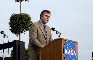 KENNEDY SPACE CENTER, FLA. - A Columbia Crew Memorial Service is held at the Shuttle Landing Facility for KSC employees and invited guests. Florida Gov. Jeb Bush is at the podium. The Columbia and her crew of seven were lost on Feb. 1, 2003, over East Texas as they returned to Earth after a 16-day research mission. Taking part in the service were NASA Administrator Sean O?Keefe, former KSC Director Robert Crippen, astronaut Jim Halsell, several employees, area clergymen, and members of Patrick Air Force Base. The service concluded with a ?Missing Man Formation Fly Over? by NASA T-38 jet aircraft.