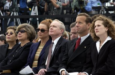 KENNEDY SPACE CENTER, FLA. - A Columbia Crew Memorial Service is held at the Shuttle Landing Facility for KSC employees and invited guests. KSC Director and former astronaut Roy D. Bridges, Jr., is seated third from right. The Columbia and her crew of seven were lost on Feb. 1, 2003, over East Texas as they returned to Earth after a 16-day research mission. Taking part in the service were NASA Administrator Sean O?Keefe, former KSC Director Robert Crippen, astronaut Jim Halsell, several employees, area clergymen, and members of Patrick Air Force Base. The service concluded with a ?Missing Man Formation Fly Over? by NASA T-38 jet aircraft.