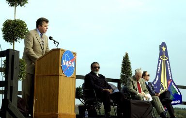 KENNEDY SPACE CENTER, FLA. - A Columbia Crew Memorial Service is held at the Shuttle Landing Facility for KSC employees and invited guests. Florida Gov. Jeb Bush is at the podium. Seated to his right are NASA Associate Deputy Administrator for Institutions & Asset Management James L. Jennings, NASA Administrator Sean O'Keefe, and Columbia's first pilot and former KSC Director Robert Crippen. The Columbia and her crew of seven were lost on Feb. 1, 2003, over East Texas as they returned to Earth after a 16-day research mission. Taking part in the service were NASA Administrator Sean O?Keefe, former KSC Director Robert Crippen, astronaut Jim Halsell, several employees, area clergymen, and members of Patrick Air Force Base. The service concluded with a ?Missing Man Formation Fly Over? by NASA T-38 jet aircraft.