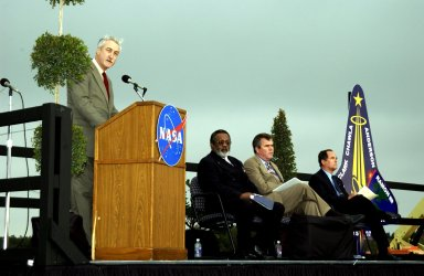 KENNEDY SPACE CENTER, FLA. - A Columbia Crew Memorial Service is held at the Shuttle Landing Facility for KSC employees and invited guests. NASA Administrator Sean O'Keefe is at the podium. Seated to his right are NASA Associate Deputy Administrator for Institutions and Asset Management James L. Jennings, Florida Gov. Jeb Bush, and Columbia's first pilot and former KSC Director Robert Crippen. The Columbia and her crew of seven were lost on Feb. 1, 2003, over East Texas as they returned to Earth after a 16-day research mission. Taking part in the service were NASA Administrator Sean O?Keefe, former KSC Director Robert Crippen, astronaut Jim Halsell, several employees, area clergymen, and members of Patrick Air Force Base. The service concluded with a ?Missing Man Formation Fly Over? by NASA T-38 jet aircraft.