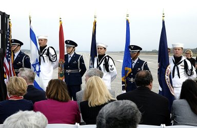 """KENNEDY SPACE CENTER, FLA. -- The Patrick Air Force Base Honor Guard stands at attention during """"Taps"""" at the conclusion of the STS-107 Columbia Crew Memorial Service held at KSC. The crew were lost on Feb. 1, 2003, over East Texas as they returned to Earth after the 16-day research mission STS-107. Also taking part in the service were NASA Administrator Sean O'Keefe, former KSC Director Robert Crippen, astronaut Jim Halsell, several employees and area clergymen. Crippen was the first to fly Columbia in 1981; Halsell first flew Columbia in 1994 and again in 1997."""
