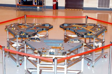 KENNEDY SPACE CENTER, FLA. - Shown are the Lander pedals for MER-1. These pedals fold up covering the Rover, which will be attached to the base pedal (not shown--empty spot in the center.) Set to launch in 2003, the MER Mission will consist of two identical rovers designed to cover roughly 110 yards each Martian day. Each rover will carry five scientific instruments that will allow it to search for evidence of liquid water that may have been present in the planet's past. The rovers will be identical to each other, but will land at different regions of Mars. The first rover has a launch window opening May 30, and the second rover a window opening June 25, 2003.