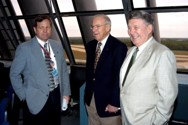 """KENNEDY SPACE CENTER, FLA. - At the KSC Launch Control Complex, former astronauts Jim Lovell (center) and Wally Schirra (right) talk with Mike Wetmore, director of Shuttle Processing (left). Lovell and Schirra visited KSC to talk about the space program and their experiences, as well as offer encouragement to workers to help get the space program """"back on its feet."""" They visited several sites around the Center, including the RLV Hangar where Columbia debris is being collected and examined as part of the investigation into the tragedy that claimed the orbiter and lives of seven astronauts returning from mission STS-107."""