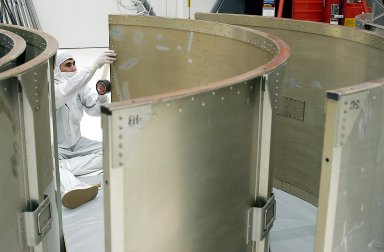 KENNEDY SPACE CENTER, FLA. -- A worker in Building AE prepares a segment of the payload canister for the Space Infrared Telescope Facility (SIRTF). SIRTF is currently scheduled for transportation to Launch Complex 17-B, Cape Canaveral Air Force Station, and mating with the Delta II on or about April 4.