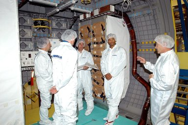 KENNEDY SPACE CENTER, FLA. - The STS-116 crew take part in training in the SPACEHAB module. From left are Mission Specialist Christer Fuglesang; a trainer; Pilot Michael Oefelein; Mission Specialist Robert Curbeam; and Commander Terrence Wilcutt. Objective of their mission to the International Space Station is to deliver and attach the third port truss segment, the P5 Truss, deactivate and retract the P6 Truss Channel 4B (port-side) solar array, and reconfigure station power from 2A and 4A solar arrays. A launch date is under review