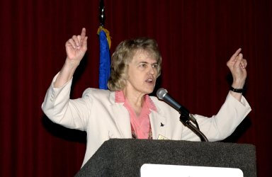 """KENNEDY SPACE CENTER, FLA. - Dr. Shannon Lucid, NASA chief scientist, speaks to attendees of a panel session during the 40th Space Congress held April 28-May 1, 2003, in Cape Canaveral, Fla. The Space Congress is an international conference that gathers attendees from the scientific community, the space industry workforce, educators and local supporting industries. This year's event commemorated the 40th anniversary of the Kennedy Space Center and the Centennial of Flight. The theme for the Space Congress was """"Linking the Past to the Future: A Celebration of Space."""