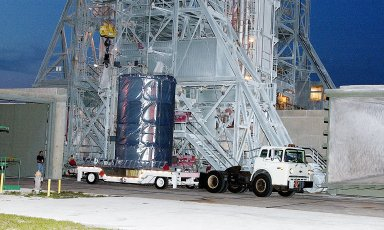 KENNEDY SPACE CENTER, FLA. - On Launch Complex 17-B, Cape Canaveral Air Force Station, the Space Infrared Telescope Facility (SIRTF) observatory is on a transporter to be taken back to NASA Spacecraft Hangar AE. SIRTF will remain in the clean room at Hangar AE until it returns to the pad in early August.
