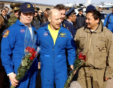 ASTANA, KAZAKHSTAN - Expedition Six Commander Ken Bowersox (center), Flight Engineer Nikolai Budarin (left) and NASA ISS Science Officer Don Pettit (not pictured) are welcomed to Kazakhstan by Cosmonaut Talgat Musabayev. The Expedition Six Soyuz capsule landed in Kazakhstan. The Expedition Six crew spent 161 days in space, 159 manning the International Space Station. Photo Credit: NASA/Bill Ingalls
