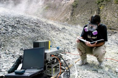 KENNEDY SPACE CENTER, FLA. - Dr. Richard Arkin records data as the hazardous gas detection system AVEMS is used to analyze the toxic gases produced by active vents, called fumaroles, in the Turrialba volcano in Costa Rica. He is using the Aircraft-based Volcanic Emission Mass Spectrometer (AVEMS) that determines the presence and concentration of various chemicals. The AVEMS system has been developed for use in the Space Shuttle program, to detect toxic gas leaks and emissions in the Shuttle?s aft compartment and the crew compartment.