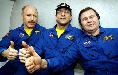 RUSSIA - Expedition Six Commander Ken Bowersox (left), NASA ISS Science Officer Don Pettit (center) and Flight Engineer Nikolai Budarin (right) celebrate their mission onboard an aircraft flight from Kazakhstan to Moscow. The Expedition Six crew spent 161 days in space, 159 manning the International Space Station. Photo Credit: NASA/Bill Ingalls