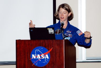 KENNEDY SPACE CENTER, FLA. - At the Florida Commission on the Status of Women held June 7 at the Debus Conference Facility, astronaut Pamela Melroy speaks to attendees. Melroy has served as pilot on two Shuttle flights (STS-92 in 2000 and STS-112 in 2002), and has logged more than 562 hours in space. The commission, through coordinating, researching, communicating, and encouraging legislation, is dedicated to empowering women from all walks of life in achieving their fullest potential, to eliminating barriers to that achievement, and to recognizing women?s accomplishments.
