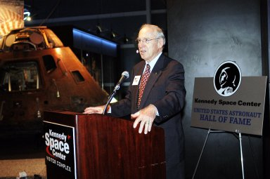 """KENNEDY SPACE CENTER, FLA. - Former astronaut James Lovell addresses the audience at a ribbon cutting ceremony officially opening the U.S. Astronaut Hall of Fame as part of the Kennedy Space Center Visitor Complex. The ceremony was held in conjunction with the induction of four Space Shuttle astronauts into the Hall of Fame including Daniel Brandenstein, Robert """"Hoot"""" Gibson, Story Musgrave, and Sally Ride. Conceived by six of the Mercury Program astronauts, the U.S. Astronaut Hall of Fame opened in 1990 to provide a place where space travelers could be remembered for their participation and accomplishments in the U.S. space program. The four new inductees join 48 previously honored astronauts from the ranks of the Gemini, Apollo, Skylab, Apollo-Soyuz, and Space Shuttle programs."""