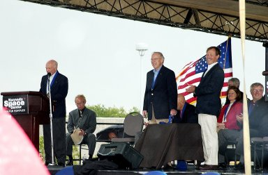 """KENNEDY SPACE CENTER, FLA. - At the KSC Visitor Complex, former astronaut John H. Glenn (at podium) presents former astronaut Robert """"Hoot"""" Gibson (standing right) at his induction ceremony into the U.S. Astronaut Hall of Fame. Also standing is former astronaut James A. Lovell. Seated on the dais, from left, are actor and Master of Ceremonies Lance Henriksen (left), and former astronauts Sally K. Ride and Daniel Brandenstein (right), both inducted into the Hall of Fame today. Also being inducted is Space Shuttle astronaut Story Musgrave. Conceived by six of the Mercury Program astronauts, the U.S. Astronaut Hall of Fame opened in 1990 to provide a place where space travelers could be remembered for their participation and accomplishments in the U.S. space program. The four new inductees join 48 previously honored astronauts from the ranks of the Gemini, Apollo, Skylab, Apollo-Soyuz, and Space Shuttle programs."""